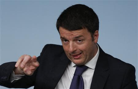 Italy's Prime Minister Renzi gestures during a news conference at Chigi Palace in Rome