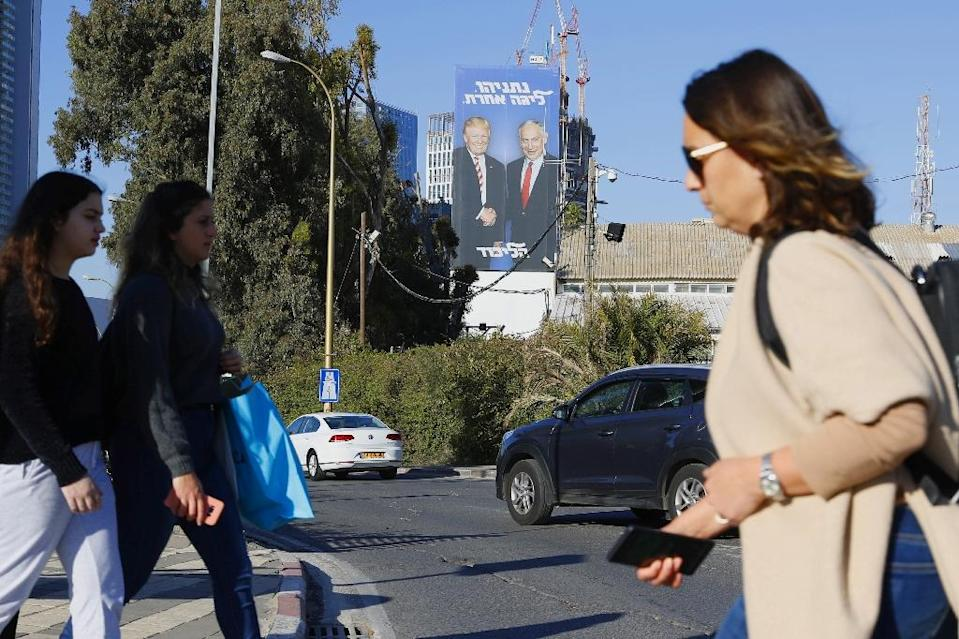 The poster has appeared elsewhere in Tel Aviv and other Israeli cities (AFP Photo/JACK GUEZ)