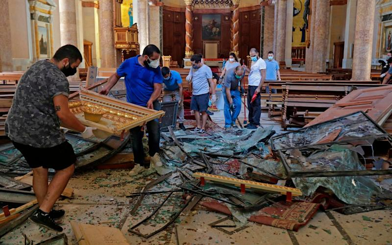 The inside of the Saint George Greek Orthodox Cathedral, located 1km from the blast site, is left in ruins - Joseph Eid/AFP