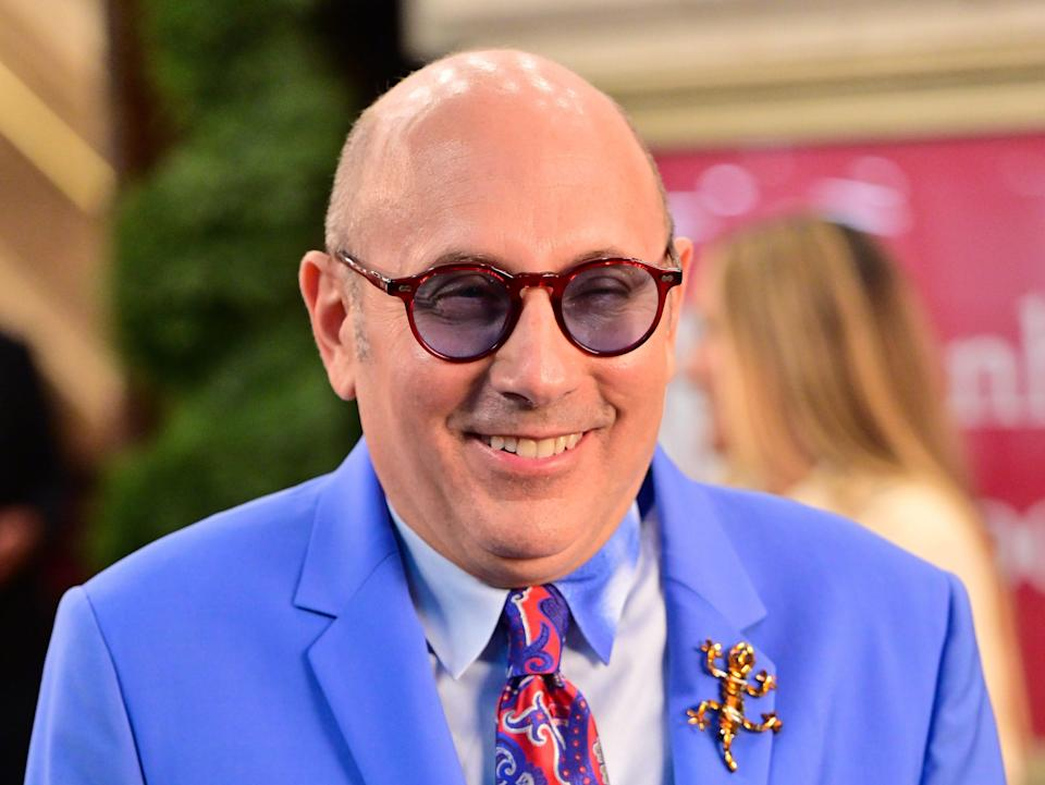 """Willie Garson on the set of """"And Just Like That..."""" in a brightly colored suit and tie."""