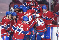 Montreal Canadiens' Jesperi Kotkaniemi (15) celebrates with teammates after scoring against the Toronto Maple Leafs during overtime in Game 6 of an NHL hockey Stanley Cup first-round playoff seres Saturday, May 29, 2021, in Montreal. (Graham Hughes/The Canadian Press via AP)