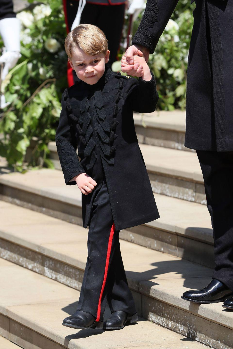 "<p>Prince George (who looks <a href=""https://www.harpersbazaar.com/celebrity/latest/a20115051/prince-george-princess-charlotte-wave-royal-wedding/"" rel=""nofollow noopener"" target=""_blank"" data-ylk=""slk:a lot less amused"" class=""link rapid-noclick-resp"">a lot less amused</a> than Princess Charlotte) also joins Prince Harry and Meghan Markle's royal nuptials, wearing a miniature version of the Blues and Royals frock coat that Prince Harry and Prince William wore for the big day.</p>"