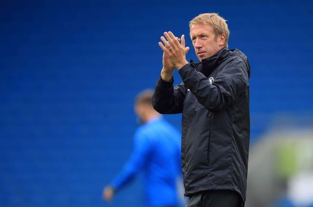 Brighton manager Graham Potter applauds the fans