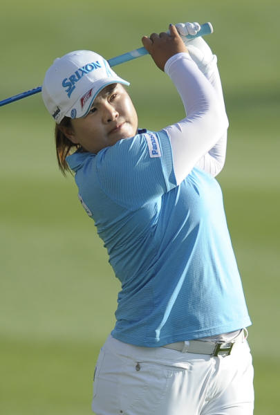 Inbee Park, of South Korea, hits on the 18th hole during the third round of the LPGA Kraft Nabisco Championship golf tournament in Rancho Mirage, Calif., Saturday, April 6, 2013. (AP Photo/Rodrigo Pena)
