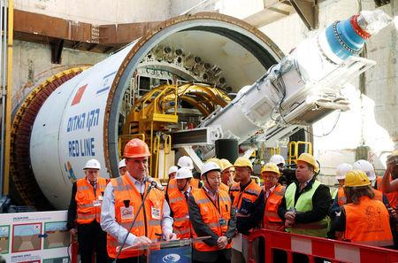 Yisrael Katz, Israel's Minister of Transport, speaks as he stands next to employees of China Railway Engineering Corporation, during an event marking the beginning of underground construction work of the light rail, using a Tunnel Boring Machine (TBM), in Tel Aviv, Israel February 19, 2017. Picture taken February 19, 2017. REUTERS/Baz Ratner