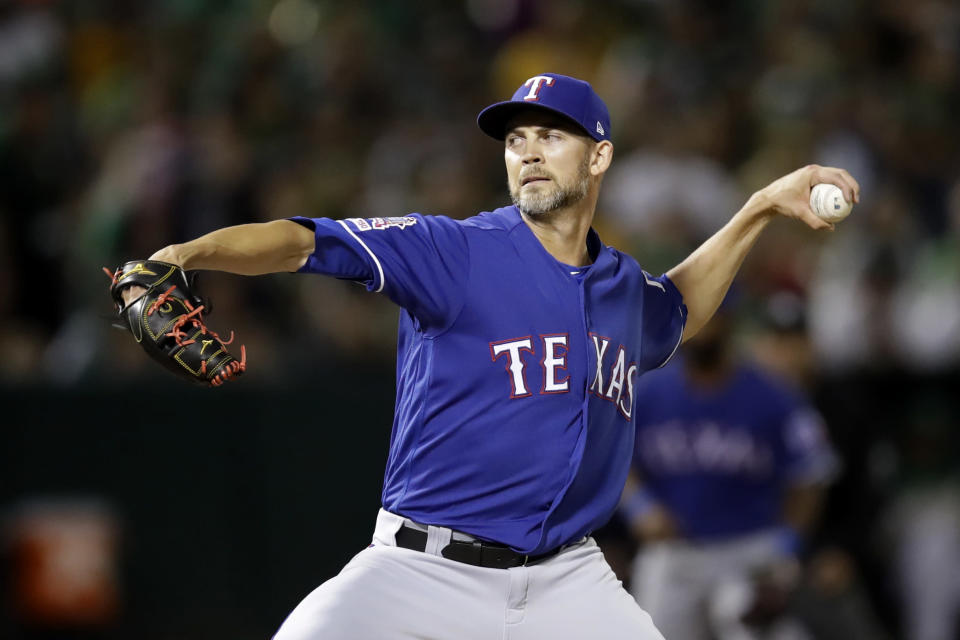 Texas Rangers pitcher Mike Minor works against the Oakland Athletics during the first inning of a baseball game Friday, Sept. 20, 2019, in Oakland, Calif. (AP Photo/Ben Margot)