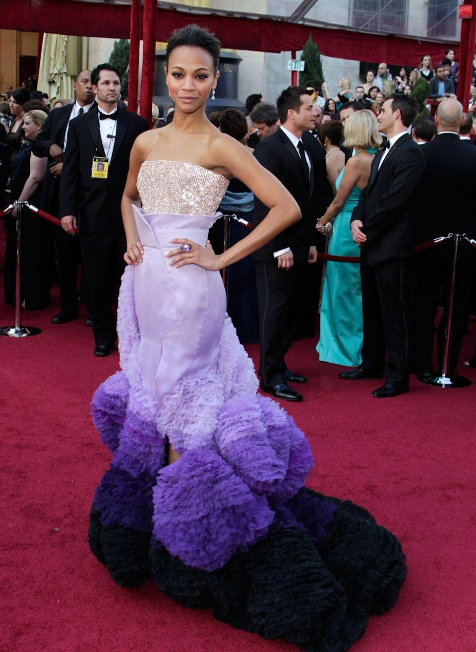 <p>Zoe Saldana's crystal bustier may be more glamorous than Rapunzel's ensemble, but her dark-purple ruffled skirt is right up the princess's alley. </p>