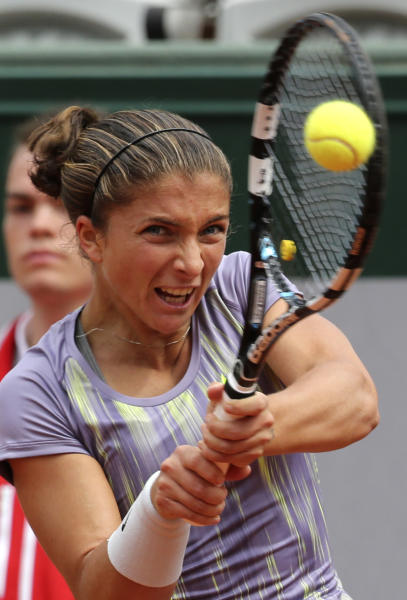 Italy's Sara Errani returns the ball to Arantxa Rus, of The Netherlands, during their first round match of the French Open tennis tournament at the Roland Garros stadium Sunday, May 26, 2013 in Paris. (AP Photo/Michel Euler)