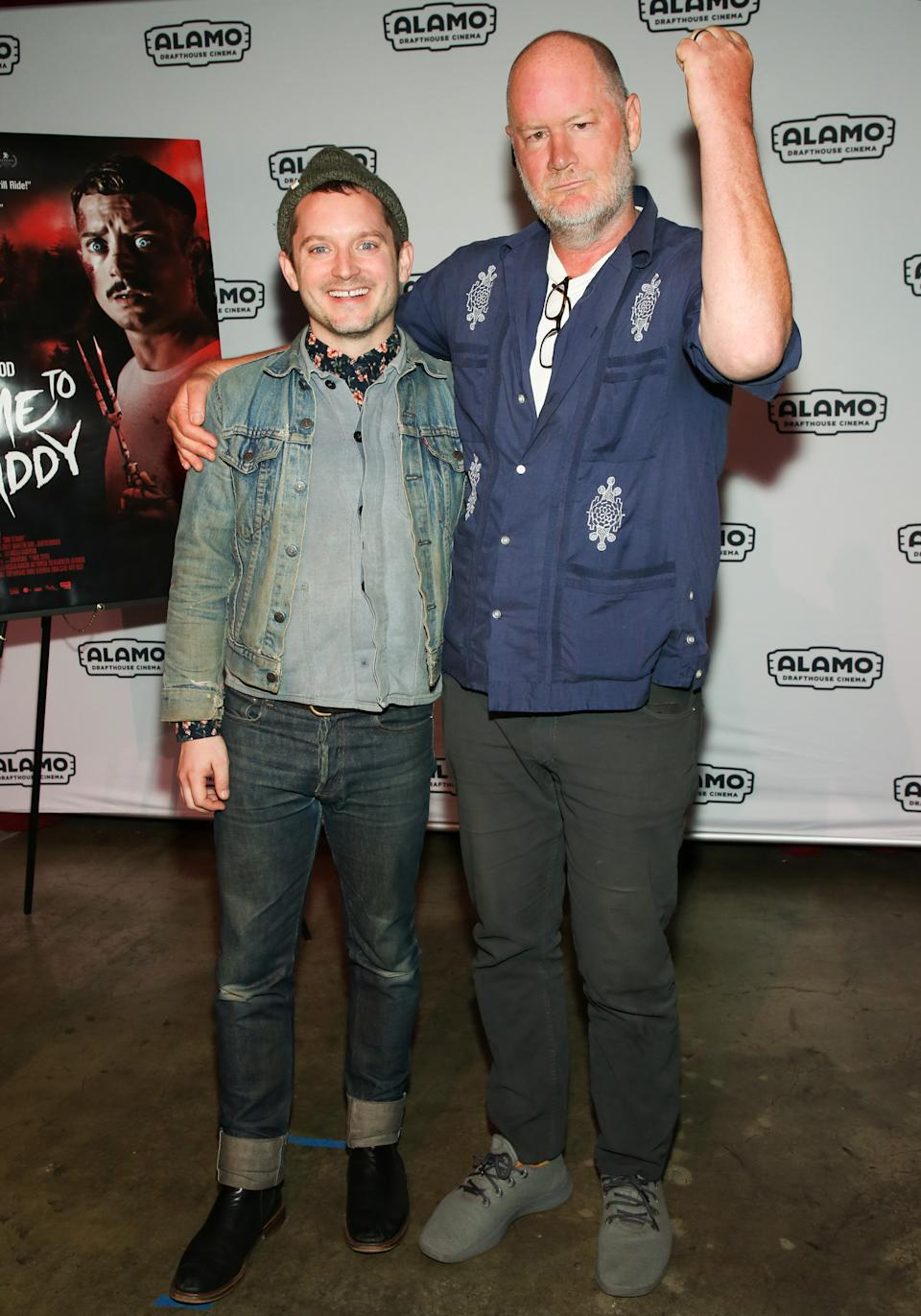 LOS ANGELES, CALIFORNIA - FEBRUARY 03: Actor Elijah Wood (L) and Director Ant Timpson (R) attend the photocall for