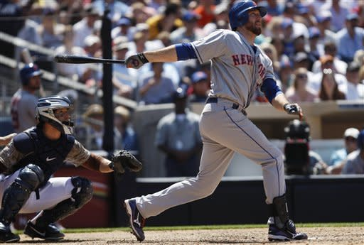 New York Mets' Ike Davis, right, watches his long drive as it heads for the right field wall against the San Diego Padres during the seventh inning of a baseball game on Sunday, Aug. 5, 2012, in San Diego. Davis got a double on the play and scored later on a sacrifice fly. (AP Photo/Lenny Ignelzi)