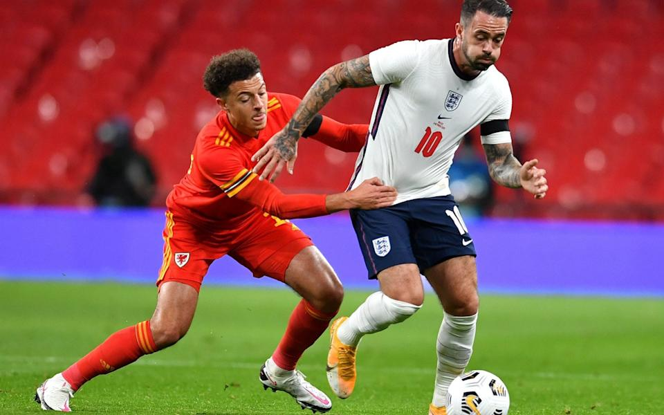 Danny Ings (R) of England in action against Ethan Ampadu (L) of Wales during the international friendly soccer match - Shutterstock