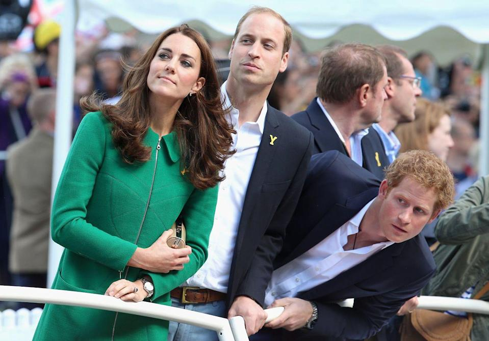 <p>If there's one thing we know royals get excited about, it's sporting events. Here, Prince Harry tries to get a better view at the Grand Départ of the Tour de France in 2014. </p>