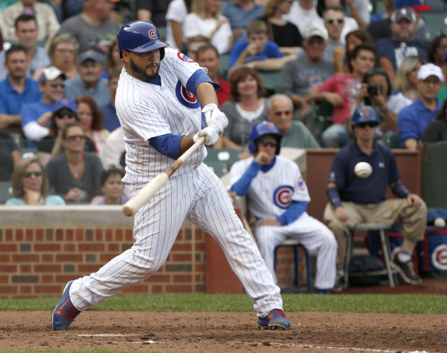 Chicago Cubs' Dioner Navarro hits a home run off Atlanta Braves relief pitcher Luis Avilan to tie the baseball game during the seventh inning Friday, Sept. 20, 2013, in Chicago. (AP Photo/Charles Rex Arbogast)