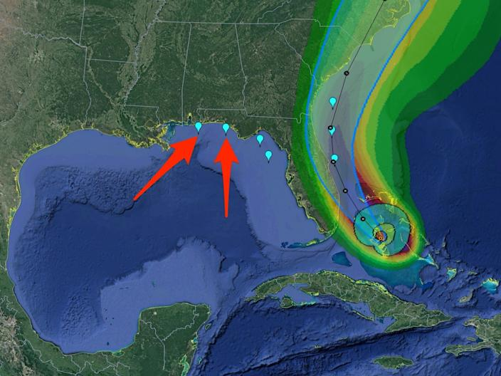 An August 1 map shows NASA and SpaceX's landing zones for the Crew Dragon Demo-2 mission amid the estimated path and conditions of Hurricane Isaias. Pensacola (left) and Panama City (right) are indicated with red arrows. The outer-edge green shows a 5-10% chance of sustained tropical storm-force winds.