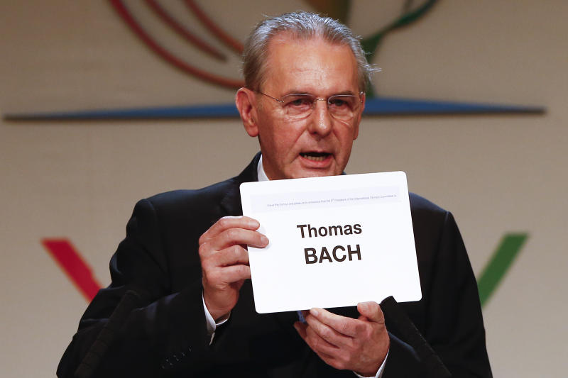 Jacques Rogge, outgoing president of the International Olympic Committee (IOC), shows the name of Thomas Bach of Germany, elected as the new IOC president during the 125th IOC session in Buenos Aires, Argentina, Tuesday, Sept. 10, 2013. (AP Photo/Victor R. Caivano)