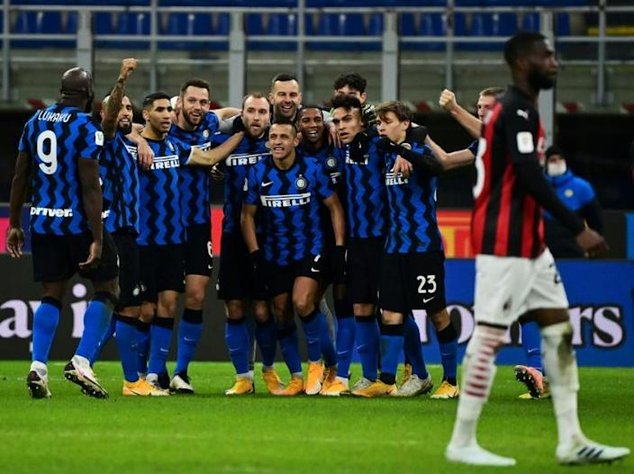 Inter Milan players celebrate after Christian Eriksen's (C) winner put them into the Italian Cup semi-finals
