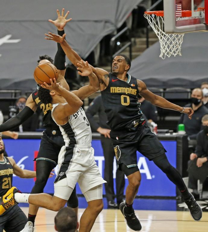 De'Anthony Melton of Memphis blocks shot attempt by San Antonio's Keldon Johnson in the Grizzlies' 129-112 NBA victory over the Spurs