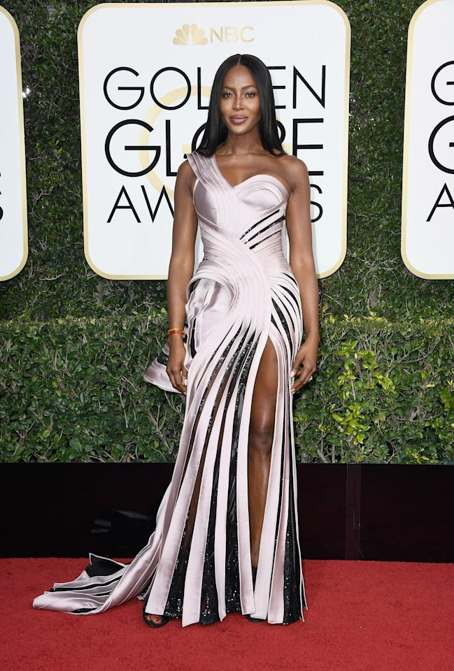"""<p><a rel=""""nofollow"""" title=""""Latest photos and news for Naomi Campbell"""" href=""""https://www.popsugar.com/Naomi-Campbell"""">Naomi Campbell</a> in a Versace gown in 2017.</p>"""