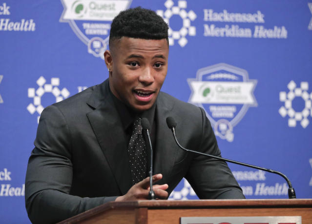 Running back Saquon Barkley answers questions during a news conference, Saturday, April 28, 2018, in East Rutherford, N.J. Barkley was selected as the number two overall pick in the NFL football draft by the New York Giants. (AP Photo/Julie Jacobson)