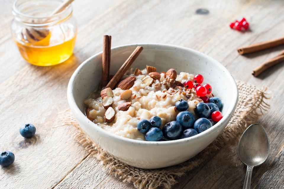 """<p>High-fiber whole grains, especially oatmeal, have been linked to lowering the <a href=""""https://www.prevention.com/health/health-conditions/g26253924/weird-heart-disease-risk-factors/"""" rel=""""nofollow noopener"""" target=""""_blank"""" data-ylk=""""slk:risk of cardiovascular disease"""" class=""""link rapid-noclick-resp"""">risk of cardiovascular disease</a>. <a href=""""https://www.ncbi.nlm.nih.gov/pubmed/20685951"""" rel=""""nofollow noopener"""" target=""""_blank"""" data-ylk=""""slk:Studies"""" class=""""link rapid-noclick-resp"""">Studies </a>have shown that just three servings of whole grains a day can decrease your risk of heart disease by 15 percent. Oatmeal for breakfast is a great way to start your day with whole grains. Add whole-wheat bread at lunch and <a href=""""https://www.prevention.com/food-nutrition/a20494431/one-pot-quinoa-recipes/"""" rel=""""nofollow noopener"""" target=""""_blank"""" data-ylk=""""slk:quinoa"""" class=""""link rapid-noclick-resp"""">quinoa</a>, barley, or brown rice at dinner<strong><br></strong></p><p><strong>Try it: </strong>These <a href=""""https://www.prevention.com/food-nutrition/recipes/g25253175/overnight-oats-recipes/"""" rel=""""nofollow noopener"""" target=""""_blank"""" data-ylk=""""slk:overnight oats recipes"""" class=""""link rapid-noclick-resp"""">overnight oats recipes</a> will come in handy for super busy mornings.</p>"""