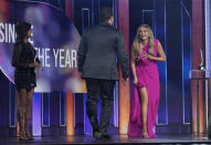 """Martina McBride, from left, presents Lee Brice and Carly Pearce with the award for single of the year for """"I Hope You're Happy Now""""at the 56th annual Academy of Country Music Awards on Sunday, April 18, 2021, at the Grand Ole Opry in Nashville, Tenn. (AP Photo/Mark Humphrey)"""