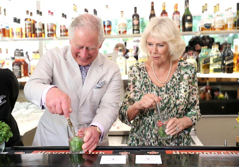 """<p>Prince Charles looks comfortable behind the bar, showing off his mixology skills as he and Camilla, Duchess of Cornwall make mojitos in Havana, Cuba. </p><p><strong>MORE</strong>: <a href=""""https://www.townandcountrymag.com/society/tradition/g36433449/princess-diana-queen-elizabeth-royals-in-florals-photos/"""" rel=""""nofollow noopener"""" target=""""_blank"""" data-ylk=""""slk:Photos of Queen Elizabeth, Meghan Markle, and More Royals Wearing Florals"""" class=""""link rapid-noclick-resp"""">Photos of Queen Elizabeth, Meghan Markle, and More Royals Wearing Florals</a></p>"""