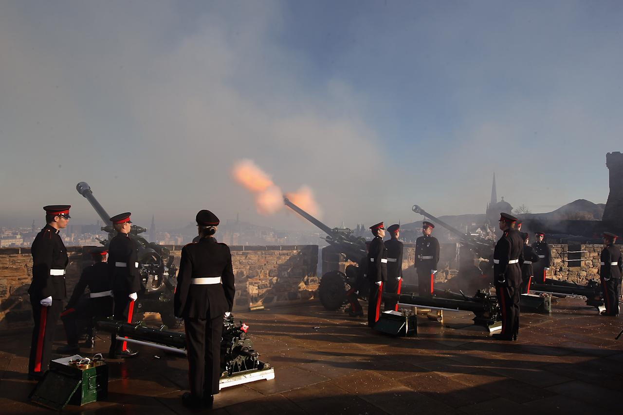 EDINBURGH, SCOTLAND - FEBRUARY 06:  Gunners from 105 Regiment Royal Artillery, fire a 21-Gun Royal Salute at Mills Mount Battery at Edinburgh Castle on February 6, 2012 in Edinburgh, Scotland. The 21-Gun Royal Salute was to mark the start of celebrations on this unique year, of Her Majesty's 60th Anniversary Accession to the Throne. Her Majesty The Queen's Diamond Jubilee takes place in 2012, marking 60 years of The Queen's reign. The Queen came to the throne on 6th February 1952. Her Coronation took place on 2nd June 1953.  (Photo by Jeff J Mitchell/Getty Images)