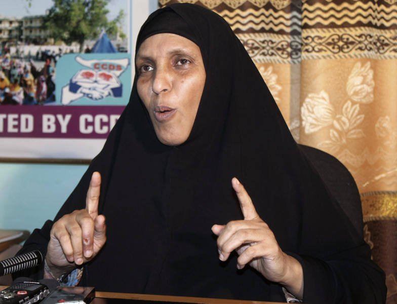 Somali education minister Maryan Qasim Arif, speaks during an interview with the Associated Press at her office in Mogadishu, Somalia, Saturday, Jan, 26, 2013. Three officials have been arrested for mismanaging a scholarship scheme that sends Somali students to Turkey, Somalia's education minister said Saturday, a sign that the fledgling government is committed to fighting the corruption that contributes to the country's failed-state status. Minister Maryan Qasim Arif said the officials were arrested for offering the scholarships to undeserving students. (AP Photo/Farah Abdi Warsameh)