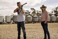"""This image released by IFC Films shows Eric Bana, left, and Genevieve O'Reilly in a scene from """"The Dry."""" (Ben King/IFC Films via AP)"""