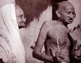 Mahatma Gandhi and his wife Kasturba, at Sevagram a village in the state of Maharashtra, India. Sevagram was the place of Mohandas Gandhi's ashram and his residence from 1936 to his death in 1948. (Photo by: Universal History Archive/Universal Images Group via Getty Images)