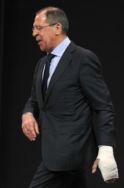 Russia's Foreign Minister Sergey Lavrov, walks out the room with a bandage on his left hand after he spoke at a media conference during a meeting of NATO foreign ministers at NATO headquarters in Brussels on Tuesday, Dec. 4, 2012. NATO foreign ministers are expected to approve Turkey's request for Patriot anti-missile systems to bolster its defense against possible strikes from neighboring Syria. (AP Photo/Yves Logghe)