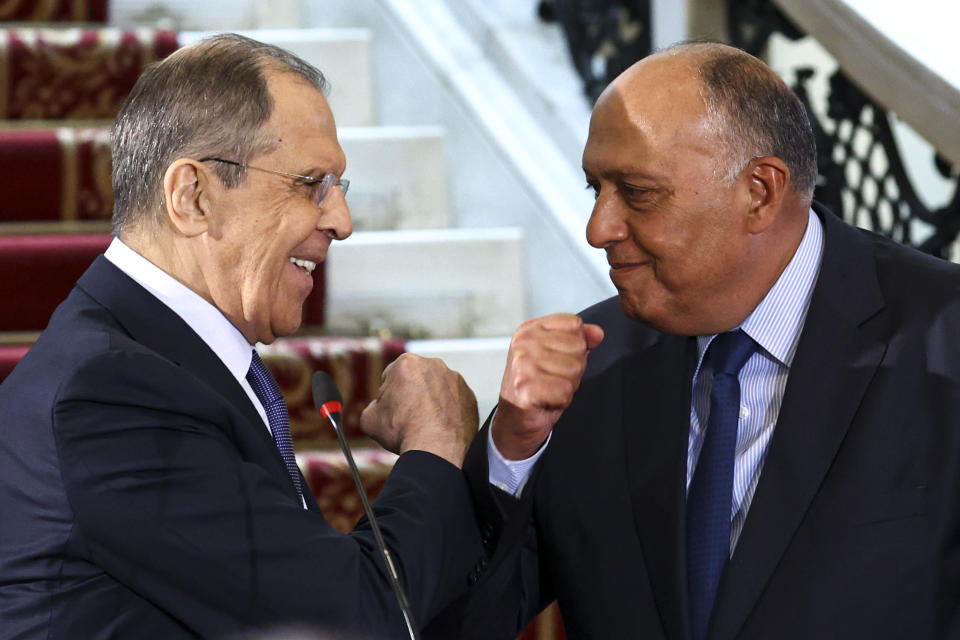 In this photo released by Russian Foreign Ministry Press Service, Egyptian Foreign Minister Sameh Shukry, right, and Russia's Foreign Minister Sergei Lavrov greet each other after a joint news conference following their talks in Cairo, Egypt, Monday, April 12, 2021. (Russian Foreign Ministry Press Service via AP)