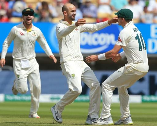 Australia's Nathan Lyon (centre) celebrates his dismissal of Joe Root in England's second innings of the first Ashes Test at Edgbaston