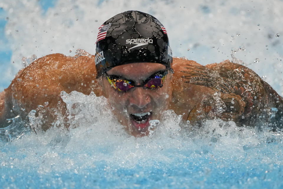 Caeleb Dressel, of United States, swims to win the gold medal in the men's 100-meter butterfly final at the 2020 Summer Olympics, Saturday, July 31, 2021, in Tokyo, Japan. (AP Photo/Gregory Bull)