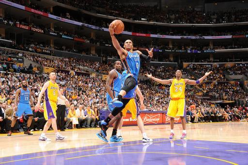 LOS ANGELES, CA - MAY 19: Russell Westbrook #0 of the Oklahoma City Thunder goes for a layup as Kobe Bryant #24 of the Los Angeles Lakers reacts in Game Four of the Western Conference Semifinals during the 2012 NBA Playoffs at Staples Center on May 19, 2012 in Los Angeles, California. (Photo by Andrew D. Bernstein/NBAE via Getty Images)