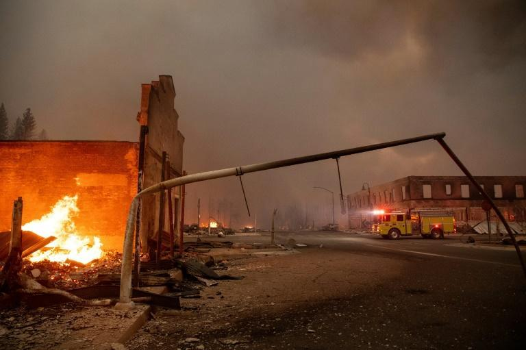The heat from the Dixie Fire bent street lights to the ground, as the blaze tore through Greenville, California