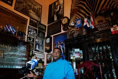Carlos Cristobal Marquez, owner of the private restaurant San Cristobal gives an interview in Havana