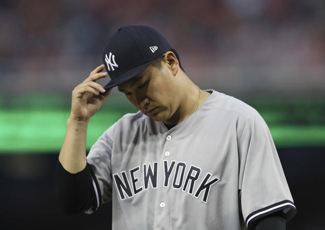 New York Yankees starting pitcher Masahiro Tanaka walks back to the dugout at the end of the second inning of an interleague baseball game against the Washington Nationals at Nationals Park, Tuesday, May 15, 2018, in Washington. (AP Photo/Pablo Martinez Monsivais)