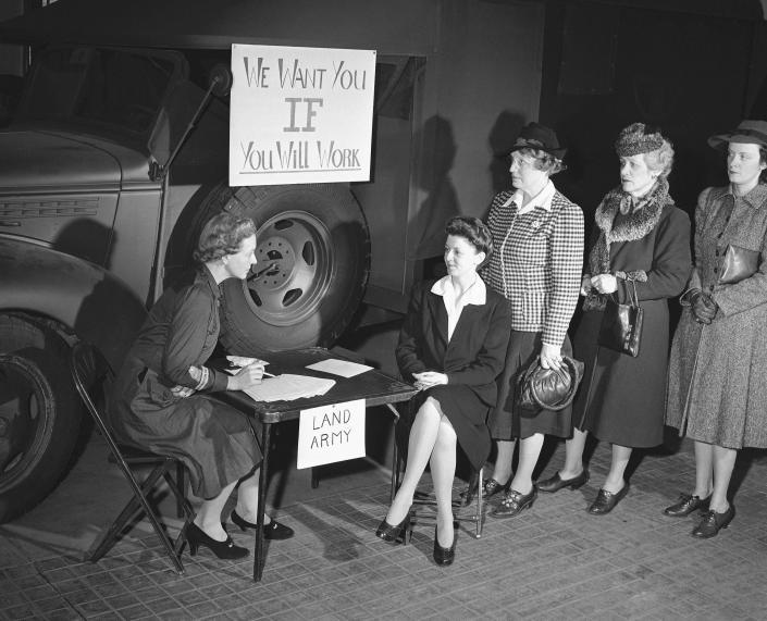 FILE - In this Jan. 23, 1941, file photo, a group of Washington women sign up, at the headquarters of the newly organized American Women's Voluntary Service Agriculture Auxiliary in Washington, to take a course in farming to help ease shortage of farm labor caused by the war. The enlisted women will start off with a course in simple gardening and progress to dairy work and poultry tending and the care of farm machinery. Left to right: Mrs. Rodman Wanamaker, Mrs. Harold J. Pearson, Mrs. M. L. Sweet, Mrs. Williams C. Knight, and Mrs. Robert Harvey. (AP Photo/William J. Smith, File)
