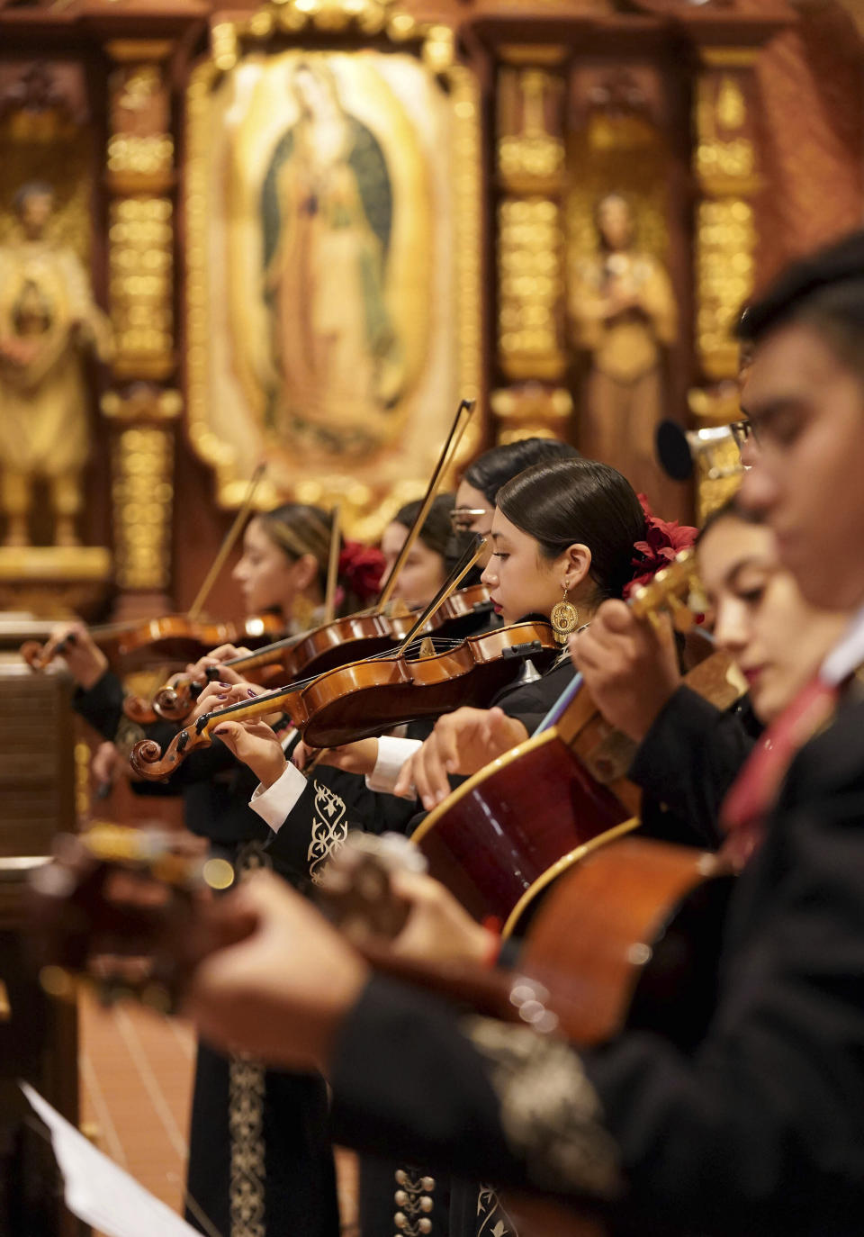 Mariachi band Los Changuitos Feos (Ugly Little Monkeys) members preform for parishioners after a morning Mass at St. Augustine Cathedral Sunday, Aug. 18, 2021 in downtown Tucson. (AP Photo/Darryl Webb)