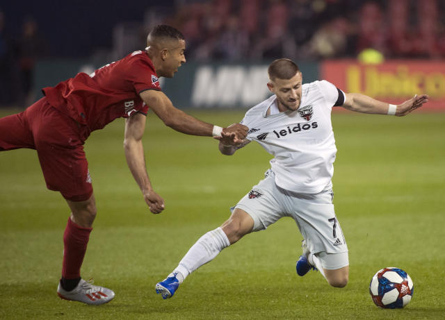 Toronto FC defender Justin Morrow (2) pulls down D.C. United forward Paul Arriola (7) during the second half of an MLS soccer game, Wednesday, May 15, 2019 in Toronto. (Nathan Denette/The Canadian Press via AP)