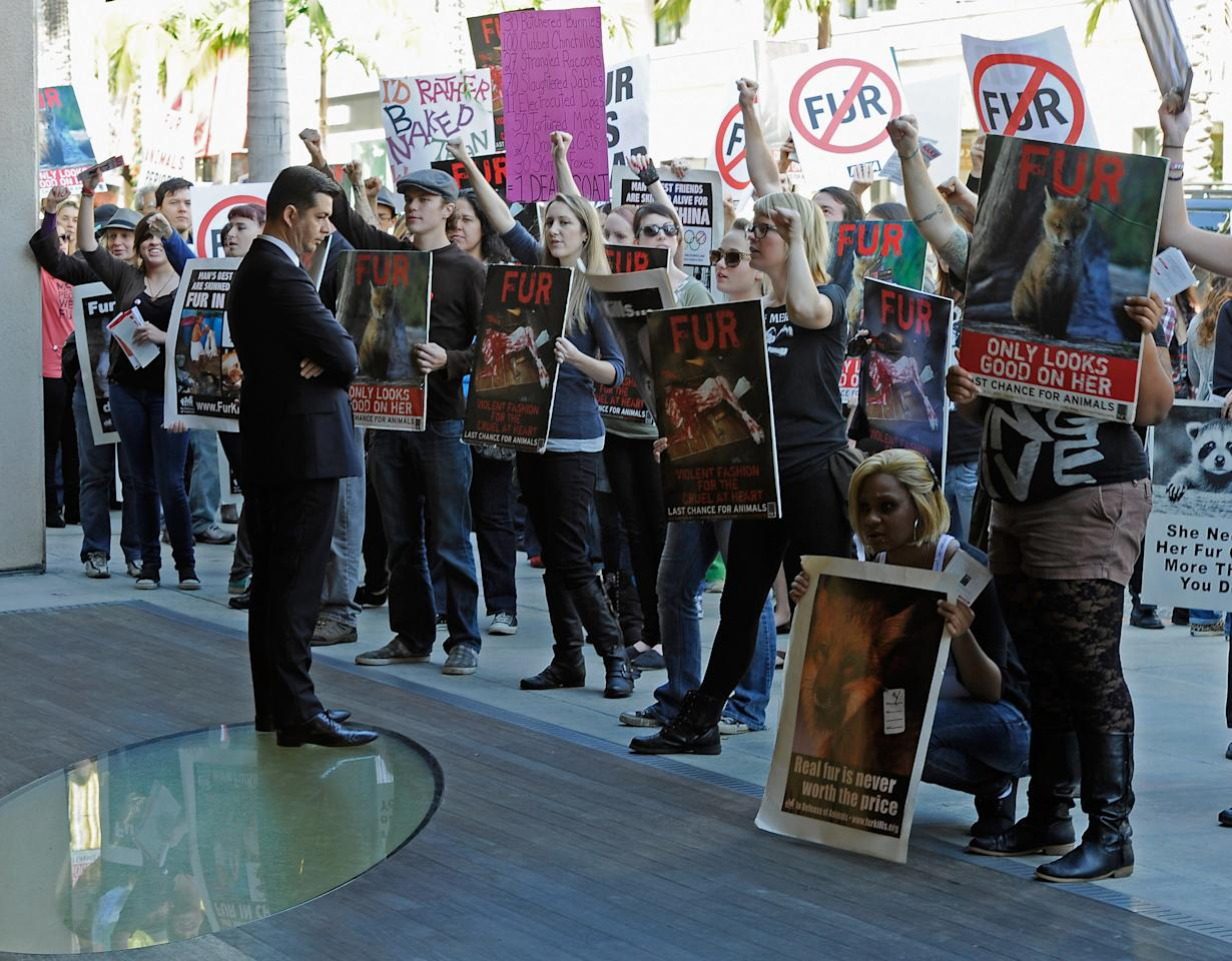 BEVERLY HILLS, CA - NOVEMBER 25:  Animal rights groups and PETA stop in front of a Prada store on Rodeo Drive during an anti-fur demonstration urging Black Friday shoppers to stop buying fur-related products on November 25, 2011 in Beverly Hills, California. Neighboring city West Hollywood unanimously approved an ordinance to ban the sale of fur clothing, the first such ban in the United States.  (Photo by Kevork Djansezian/Getty Images)
