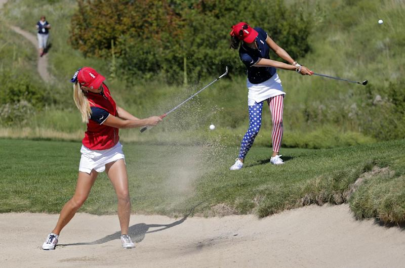 United States' Jessica Korda, left, and teammate Michelle Wie practice hitting to the second hole during a practice round for the Solheim Cup golf tournament, Thursday, Aug. 15, 2013, in Parker, Colo. The Solheim Cup, a biennial event between teams representing Europe and the United States, starts Friday. (AP Photo/Ed Andrieski)
