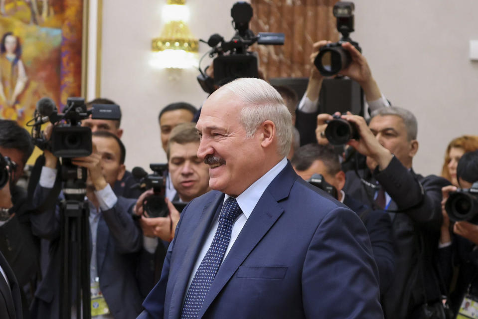Belarus President Alexander Lukashenko smiles as he greets prime ministers from countries that were once part of the former Soviet Union at a meeting in Minsk, Belarus, on Friday, May 28, 2021. Lukashenko, who has led the former Soviet nation of 9.3 million for more than a quarter century, has faced unprecedented protests after his reelection to a sixth term in a vote in August 2020 that the opposition rejects as rigged. He has responded to the demonstrations with a fierce clampdown that has left more than 35,000 people arrested and thousands of them beaten. (Maxim Guchek/BelTA Pool Photo via AP)