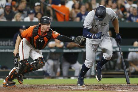 Jul 9, 2018; Baltimore, MD, USA; Baltimore Orioles catcher Chance Sisco (15) reaches for a tag on New York Yankees right fielder Aaron Judge (99) after a strikeout in the seventh inning at Oriole Park at Camden Yards. Mandatory Credit: Geoff Burke-USA TODAY Sports