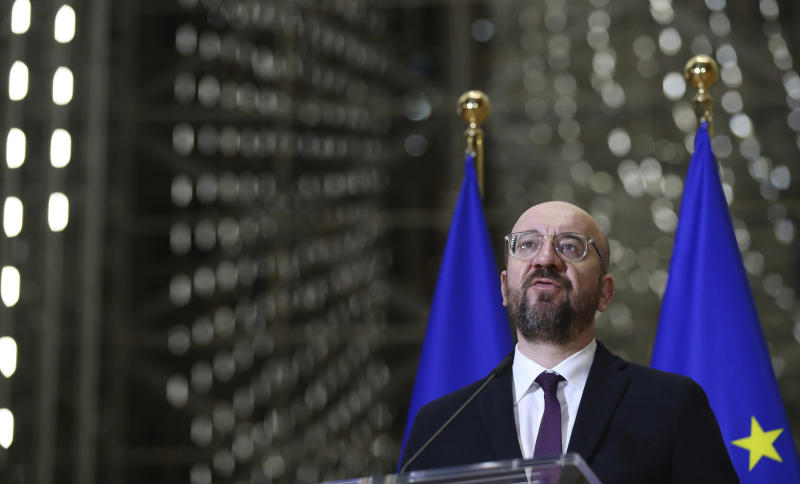 European Council President Charles Michel speaks during a media conference after an EU summit by video conference in Brussels, Thursday, March 26, 2020. Following the informal video conference, members of the European Council adopted a statement on the EU actions in response to the COVID-19 outbreak. The new coronavirus causes mild or moderate symptoms for most people, but for some, especially older adults and people with existing health problems, it can cause more severe illness or death. (Francois Walschaerts, Pool Photo via AP)