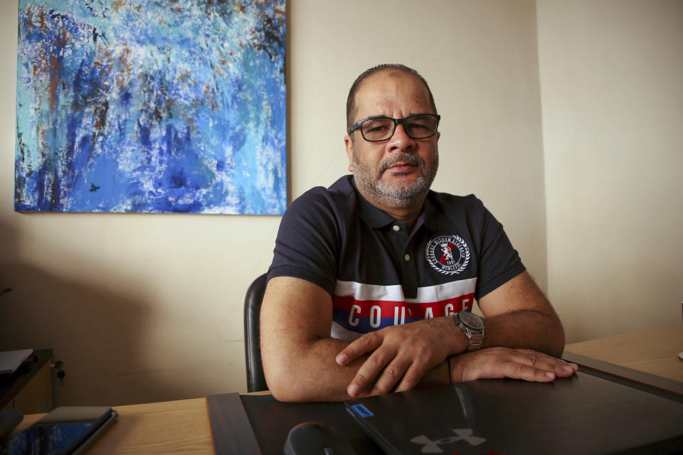 """In this Sept. 12, 2021, photo Egyptian Yasser Ebrahim, who was detained in New York following the Sept. 11 attacks, held under no charges and ultimately deported, poses for a photograph in his home, in Alexandria, Egypt. He was an original plaintiff in a 2002 lawsuit. In 2009 he and four others, including his brother, reached a $1.26 million settlement on the lawsuit. Though not an apology, """"we thought it was sort of admitting that something wrong was done to us."""" (AP Photo/Ravy Shaker)"""