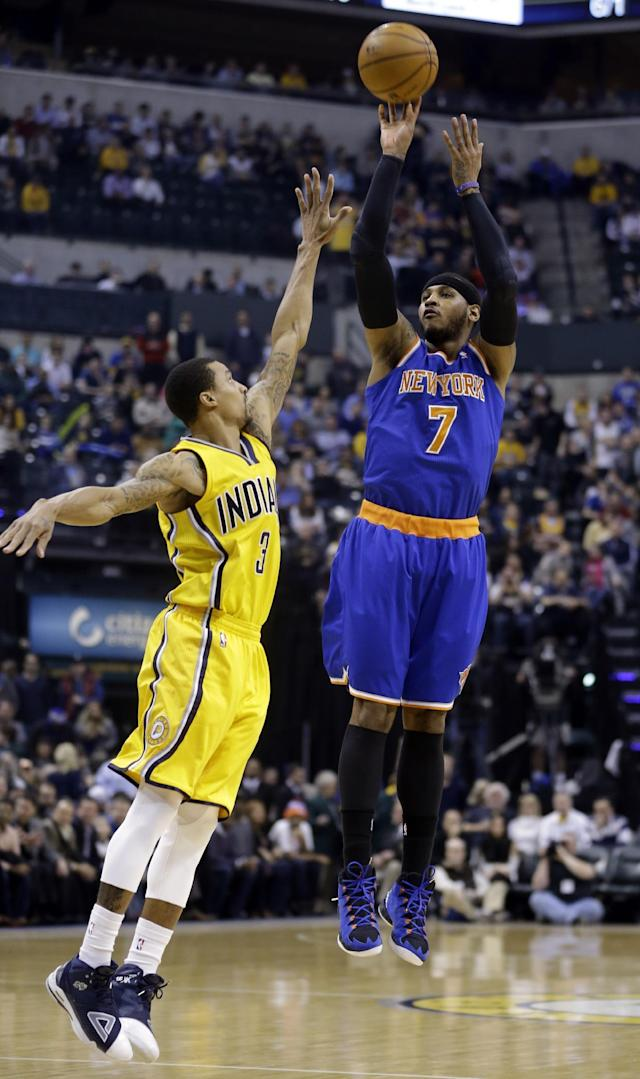New York Knicks forward Carmelo Anthony, right, shoots over Indiana Pacers guard George Hill during the first half of an NBA basketball game in Indianapolis, Thursday, Jan. 16, 2014. (AP Photo/Michael Conroy)