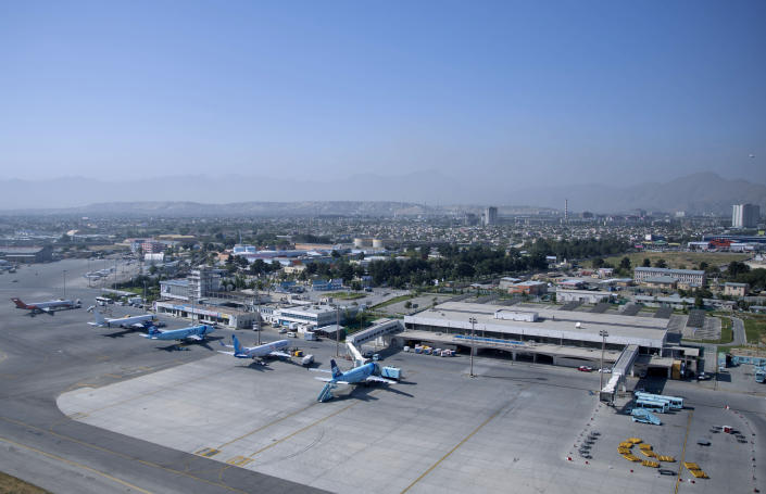 FILE - This July 25, 2015, file photo shows Hamid Karzai International airport in Kabul, Afghanistan. With the U.S. leading the withdrawal from Afghanistan, European allies and Canada want to hear more about President Joe Biden's thinking. They are concerned about how security will be assured at their embassies, along major transport routes and above all at Kabul's airport. (AP Photo/Massoud Hossaini, File)