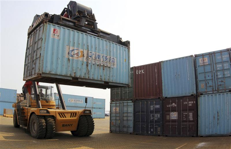 A forklift transfers a shipping container for export at a port in Lianyungan